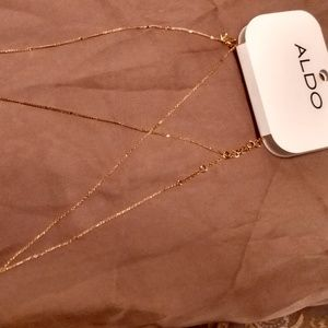 Gold chain with layered or double pendants.